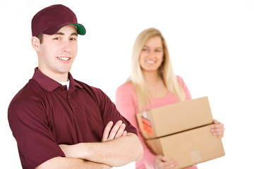 Shipping: Trustworthy Delivery Man With Customer Behind