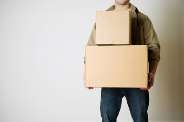 Moving: Anonymous Man Carrying Cardboard Moving Boxes