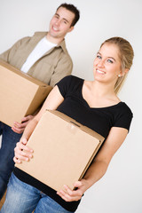 Moving: Smiling Couple Carrying Boxes