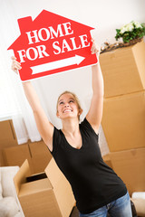 Moving: Woman Holds Up Home Sale Sign