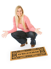 Moving: Woman Posing With Welcome Mat