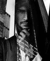 Keuken foto achterwand Artist KB Conceptual portrait of a handsome man with an urban landscape in the background