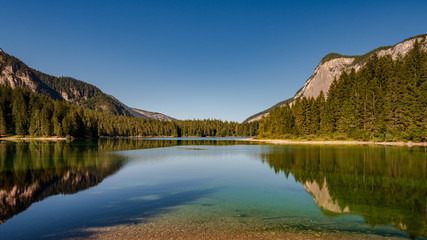 .Beautiful view of Lake Tovel, the largest of all natural lakes in Trentino in the Adamello Brenta Park.