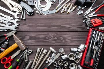 tools and auto spare parts on wooden workbench. copy space Wall mural