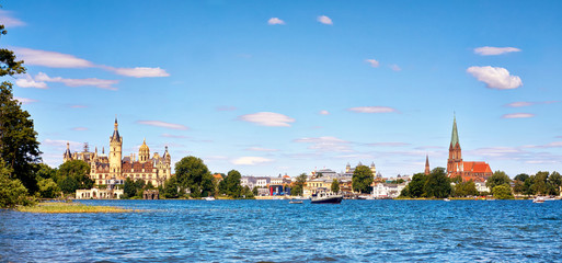 View over the lake Schwerin with castle and cathedral in the background.