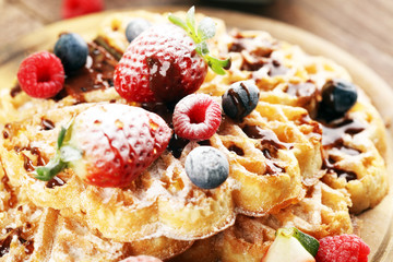 Waffle. Traditional belgian waffles with fresh fruit and powder sugar on wood