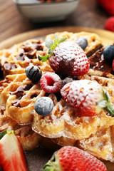 Waffle. Traditional belgian waffles with fresh fruit and powder sugar on wood