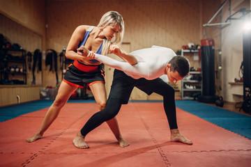 Woman makes elbow kick, self-defense workout