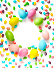 Easter eggs and candy background with copy space