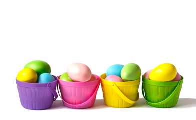 Easter decoration eggs in colorful baskets on white background, copy space