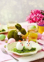 Funny chickens from eggs on the Easter table. Easter table setting