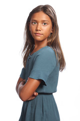 Mixed race girl green eyes with arms folded