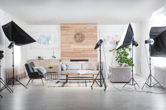 Professional photo studio equipment prepared for shooting living room interior