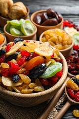 Composition with different dried fruits on wooden background. Healthy lifestyle