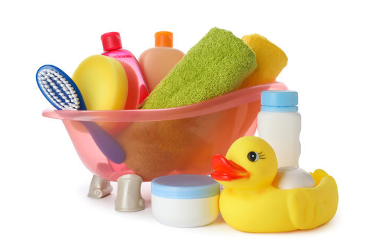 Baby bathing accessories and toy on white background