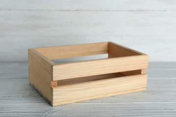 Wooden crate on table against light background. Space for text
