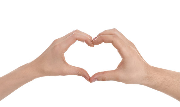 Man and woman making heart with their hands on white background, closeup