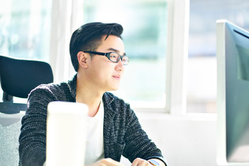 young asian businessman working in office Fototapete