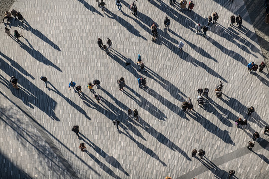 People crowd walking on around city square view from the top