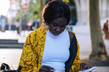 Young woman reading from notebook