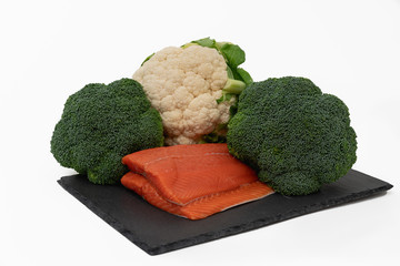 Fresh salmon fillet, broccoli and cauliflower isolated on white