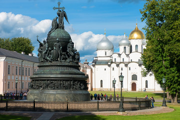 VELIKY NOVGOROD, RUSSIA - AUGUST 14, 2018: Monument Millenium of Russia on the background of St. Sophia Cathedral with tourists walking along in summer day