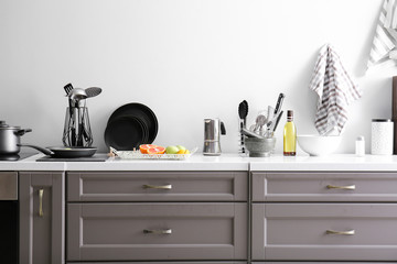 Utensils with products on counter in kitchen