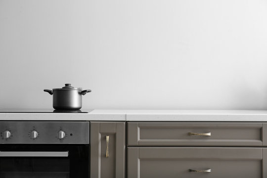 Saucepan on electric stove on counter in kitchen