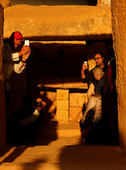 Visitors photograph the sunrise at the megalithic Mnajdra Temples during the vernal equinox marking the beginning of Spring, outside Qrendi