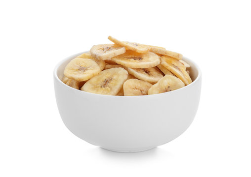 Bowl with tasty dried banana on white background