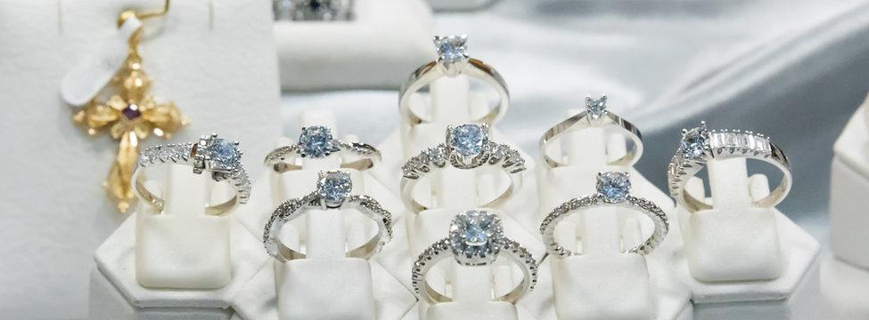 Jewelry diamond rings show in luxury retail store window display showcase