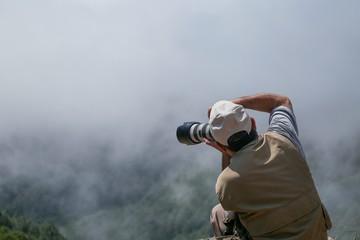 a man takes a landscape photo