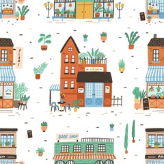 Fototapete - Seamless pattern with city buildings on white background. Backdrop with facades of bakery or bakeshop, book store, plant shop. Cute flat vector illustration for wrapping paper, textile print.