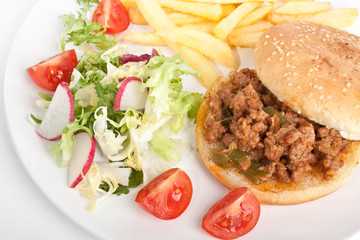 Sloppy Joe minced meat sandwich with french fries and salad