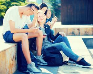 teenagers communicate in schoolyard