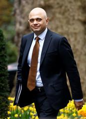 Britain's Home Secretary Sajid Javid walks outside Downing Street in London