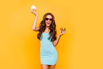 Close up photo beautiful her she wavy lady  hands arms little package box sweets weekend lazy food recommend wear specs blue teal green everyday short dress clothes isolated yellow background