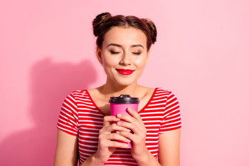 Close-up portrait of her she nice cute attractive lovely winsome sweet tender cheerful girl wearing striped t-shirt smelling hot chocolate isolated on pink pastel background