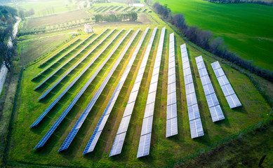 Obraz aerial view of solar panels on a sunny day. power farm producing clean energy - fototapety do salonu