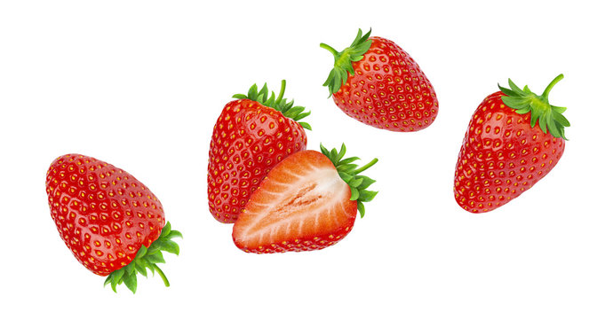 Falling strawberries isolated on white background