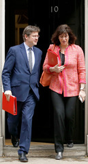 Britain's Secretary of State for Business Clark and Minister of State for Energy Perry step out on Downing Street in London