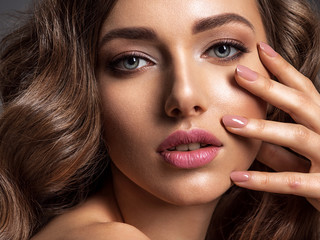 Beautiful woman with natural color of nails.