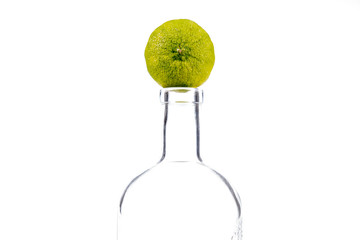 glass bottle with a lime on top