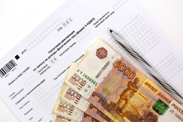 Russian documents, income Declaration Form 3-NDFL, cash 5000 rubles and a pen.