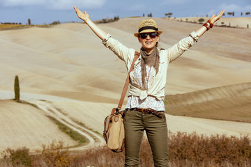 smiling fit woman on summer hiking in Tuscany ,Italy rejoicing