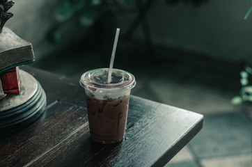 A glass of cold cocoa is located on a table in one cafe. 1