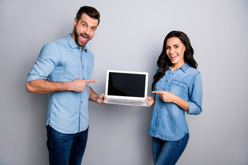 Close up photo sell managers she her he him his lady guy direct indicate finger notebook new model recommend advise buy buyer wear casual jeans denim shirts outfit clothes isolated grey background