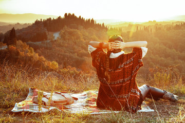 relaxed fit solo traveller woman sitting on blanket