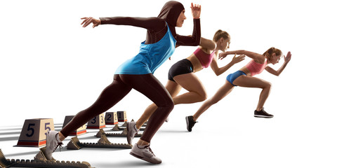 Isolated Female athletes sprinting. Women on white background in sport clothes on starting line...