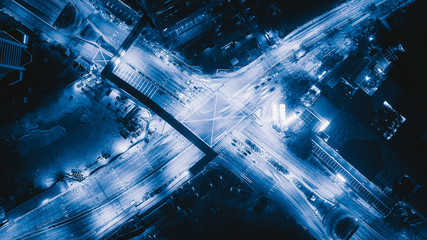 Aerial view of highway junctions shape letter x cross at night. Bridges, roads, or streets in transportation concept. Structure shapes of architecture in urban city, Kuala Lumpur Downtown, Malaysia